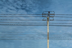 Electric pole and electricity line with against blue cloudy sky,. Abstract background Stock Photos