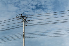 Electric pole and electricity line with against blue cloudy sky,. Abstract background Stock Photo