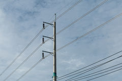 Electric pole and electricity line with against blue cloudy sky, Stock Photo