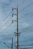Electric pole and electricity line with against blue cloudy sky, Royalty Free Stock Photos