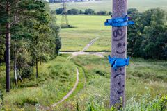 Electric pole with faces. View from a high point to a splashing rural roadnn royalty free stock photos