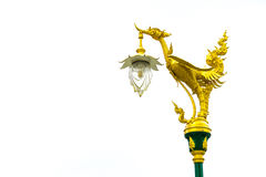 Electric pole with golden thai traditional swan on top Stock Photo