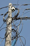 Electric pole with lines of cables Royalty Free Stock Photos