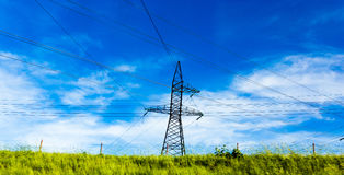 Electric pole on nature in spring Stock Photography