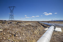 Electric pole and pipe in Iceland Royalty Free Stock Photos