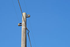 Electric pole. S on the ground during a cloudy stock image