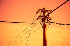 Electric pole and power line Stock Images