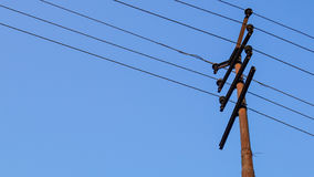 Electric pole or power pole with old power line. Royalty Free Stock Images