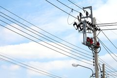 Electric pole power Tangle wire danger, wire electrical energy at street road on sky background Royalty Free Stock Image