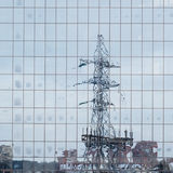 Electric pole reflected in windows of office Stock Image
