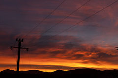 Electric pole and sunset Royalty Free Stock Photography