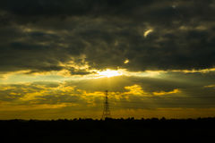 Electric pole sunset Stock Photography