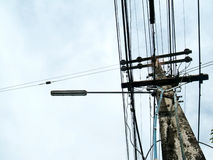 Electric pole with wires across. Stock Photos