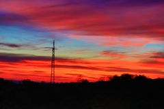 Electric pole colorful sunset skies Stock Photo