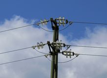 Electric pole. With wires over blue sky and clouds Stock Photo