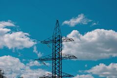 Electric pole, wires and sky with clouds 2 Royalty Free Stock Image
