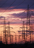 Electric poles. In the distance on sunset stock images