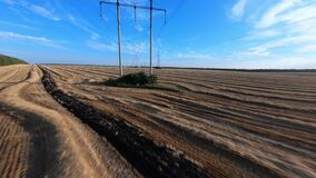 Electric poles on agricultural field