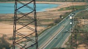 Electric poles in barren wasteland near the high way in Ukraine. Electric post in barren wasteland landscape in Ukraine stock video footage