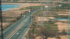 Electric poles in barren wasteland near the road in Ukraine. Electric post in barren wasteland landscape in Ukraine stock video