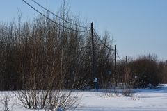 Electric poles. Away from the village stock images