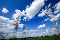 Electric poles in a field Stock Photos