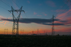 Electric poles. Landscape with power lines against the background of sunset royalty free stock photography