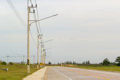 Electric poles beside the street Stock Photos