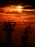 Electric poles on sunset Royalty Free Stock Images