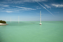 Electric poles in the water at Florida Keys Stock Image