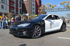 Electric police car Tesla during the 117th Golden Dragon Parade Stock Photography