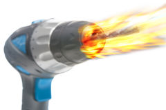 Electric portrable drill burning in fire, composite image Stock Images