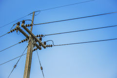 Electric post and blue sky Royalty Free Stock Photos
