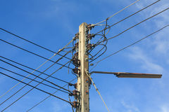 Electric post with cable and light Royalty Free Stock Photo