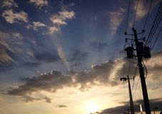 Electric poste at sunset Stock Photos