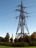 Electric power. High voltage electric line metallic tower Stock Images
