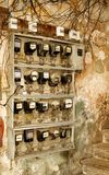 Electric power counters, old Havana, Cuba. Electric power counters on rough wall, old Havana, Cuba Stock Photos