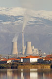 Electric Power Generation Plant. A plant generating electric power behind a lake and a village in northern Greece stock photo