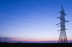 Electric power line. On clear sky after sunset royalty free stock photo