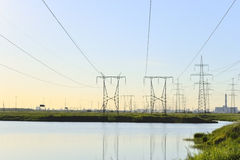 Electric power line. View of the Electricity pylons on sunset background Royalty Free Stock Photos
