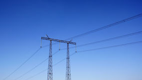 Electric power line. Over deep blue sky background royalty free stock images