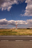 Electric power line and road Stock Photo