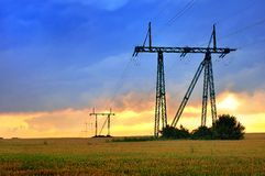 Electric power line at sunset Stock Photos