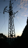 Electric power line tower. Silhouette of an electric power line tower after sunset Stock Photography