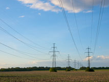 Electric power lines. Two electric powerlines over fields stock images