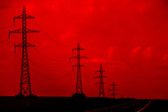 Electric Power Lines. Danger: Electricity. Electric Power Transmission Lines Over An Apocalyptic Sky Royalty Free Stock Image