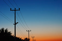 Electric power lines against a dawn sky Stock Image