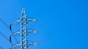 Electric power lines on blue sky Royalty Free Stock Photos