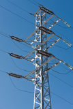 Electric power lines. On a blue sky background Stock Image