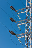 Electric power lines. On a blue sky background Royalty Free Stock Images